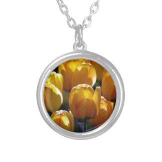 Tulips aglow round pendant necklace