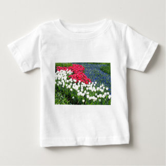Tulips field in red and white with blue hyacinths baby T-Shirt