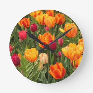 Tulips in red and yellow shades round clock