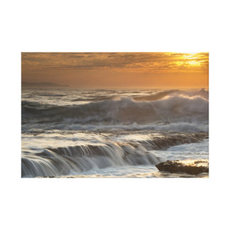 Tumultuous waves covering rocks canvas print