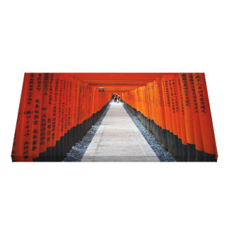 Tunnel of red shrine gates at Fushimi Inari, Kyoto Stretched Canvas Print
