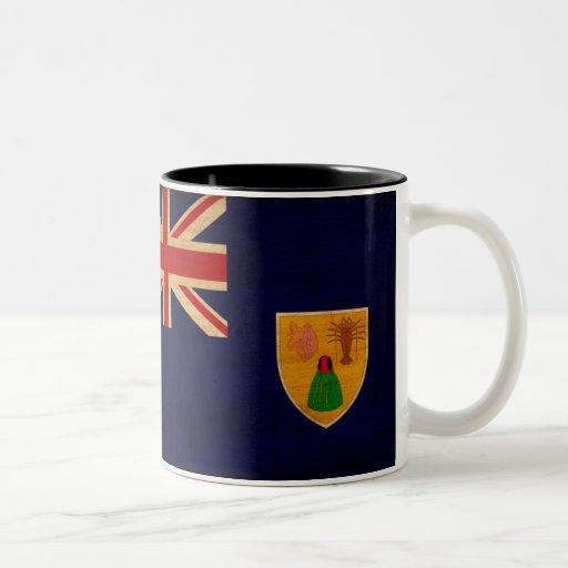 Turcos y taza de la bandera de Caicos
