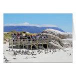 Turistas en la playa de los cantos rodados que mir