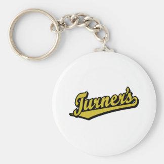 Turner's script logo in Gold Key Chains