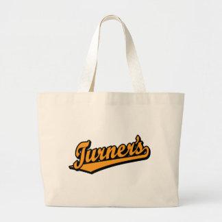 Turner's script logo in Orange Bags