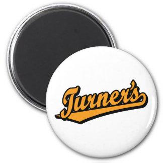 Turner's script logo in Orange Magnet