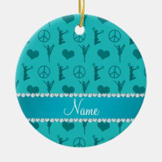 Turquesa conocida que anima el signo de la paz de adorno navideño redondo de cerámica