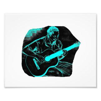 turquesa negra invertida del jugador de la guitarr fotografias