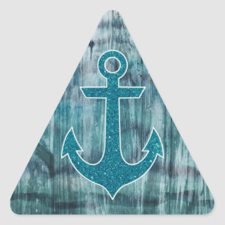 Turquesa y ancla náutica azul del brillo en la pegatina triangular