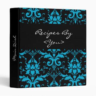Turquesa y carpeta negra del libro de la receta
