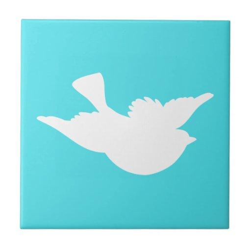 Turquesa y silueta blanca del pájaro tejas  ceramicas