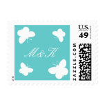 Turquoise and white butterfly stamps for weddings
