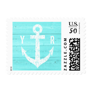 Turquoise blue stamps with weathered boat anchor
