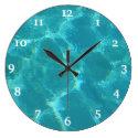 Turquoise Blue Water Wall Clock (<em>$33.10</em>)