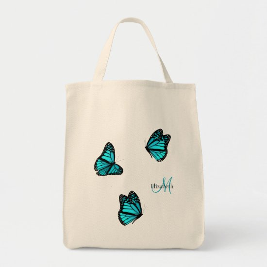 turquoise butterflies flitting on a breeze tote bag