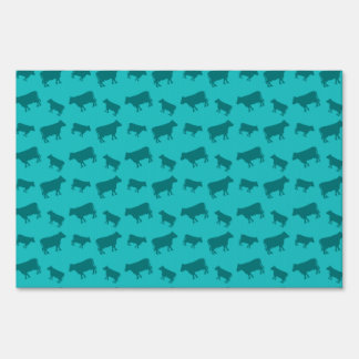Turquoise cow pattern lawn signs