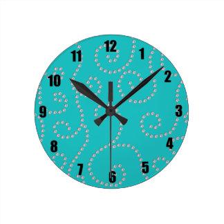 Turquoise diamond swirls round wall clock