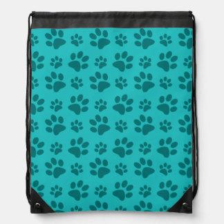 Turquoise dog paw print drawstring bags