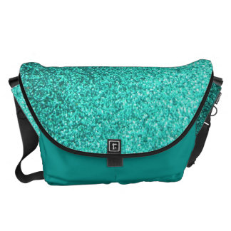 Turquoise faux glitter graphic messenger bags