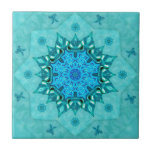 """Turquoise Nature Mandala Ceramic Tile<br><div class=""""desc"""">A soothing lotus mandala in shades of lapis blue,  cobalt,  aqua and turquoise,  created from original photos of blue and green beach glass; there is quite a bit lotus pond activity to see in the design,  including butterflies and Koi fish.</div>"""