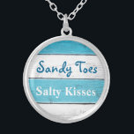 """Turquoise Sandy Toes Salty Kisses Necklace<br><div class=""""desc"""">This fun and tropical silver plated necklace is accented with the cute saying """"Sandy Toes Salty Kisses"""" on a turquoise and white striped background,  making it a sweet gift for the bride,  bridesmaids or flower girl.</div>"""