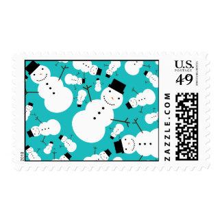 Turquoise snowmen postage stamp