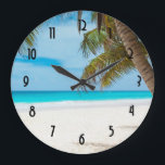"""Turquoise Tropical Beach Large Clock<br><div class=""""desc"""">Secluded serene and peaceful tropical white sand beach. Calm turquoise waters and a few palm trees for shade. The perfect location for some rest and relaxation.</div>"""
