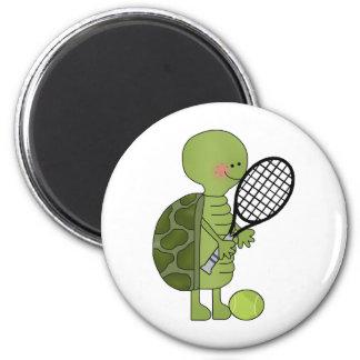 Turtle playing tennis magnet