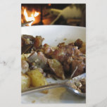 "Tuscan typical recipe of baked pork and potatoes<br><div class=""desc"">Tuscan typical recipe of baked pork and potatoes in a country atmosphere with burning fireplace</div>"