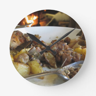 Tuscan typical recipe of baked pork and potatoes round clock