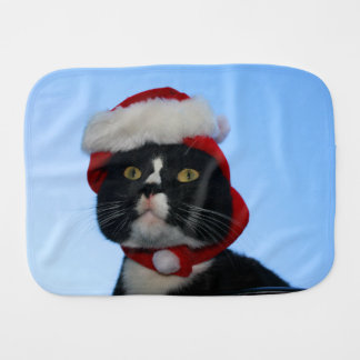 Tuxedo black and white cat with santa hat on burp cloths