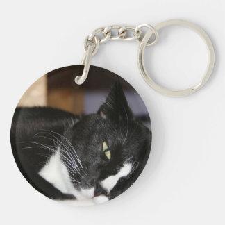 tuxedo cat black and white lying down one eye open key chains