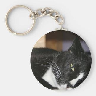 tuxedo cat black and white lying down one eye open keychains