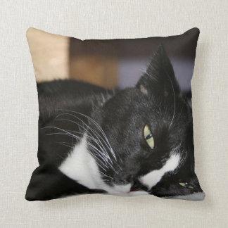 tuxedo cat black and white lying down one eye open throw pillow