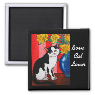 Tuxedo cat with daffodils in a blue vase magnet