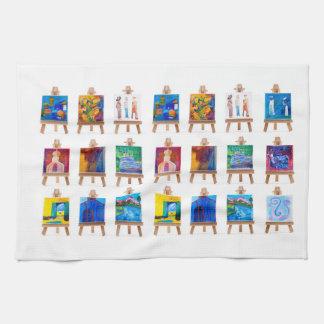 Twelve mini paintings on easels isolated on white hand towel