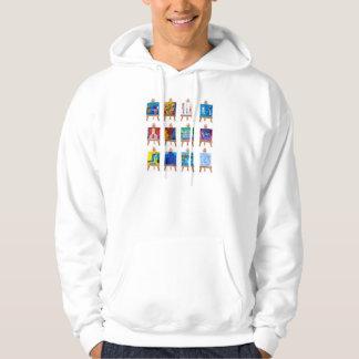 Twelve mini paintings on easels isolated on white hooded sweatshirt