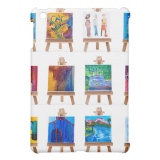 Twelve mini paintings on easels isolated on white iPad mini covers