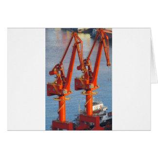 twin construction cranes look like birds dinosaurs greeting card