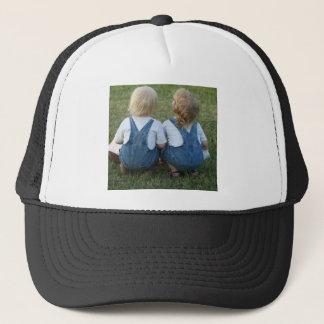 twins looking away trucker hat