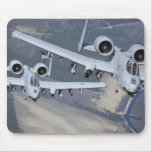 Two A-10C Thunderbolt II aircraft fly in format Mousepad