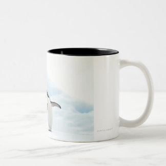 Two Adelie Penguins sitting on a sheet of ice Two-Tone Coffee Mug