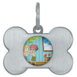 Two adorable kids exchanging their christmas gifts pet name tag
