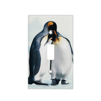 Two affectionate penguins light switch cover