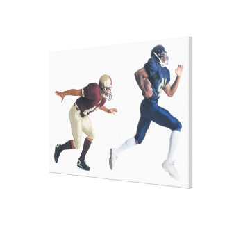 two african american american football players canvas print