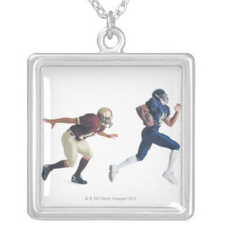 two african american american football players pendants