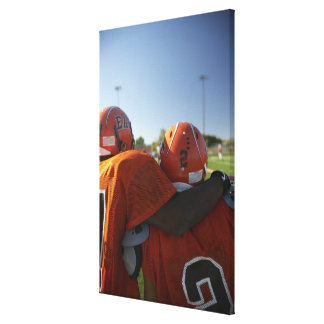 Two American football players looking at playing Canvas Print