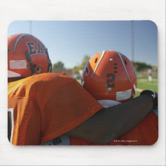 Two American football players looking at playing Mouse Pad