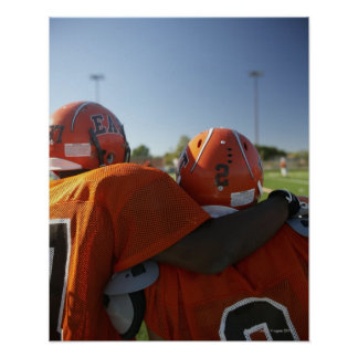 Two American football players looking at playing Poster