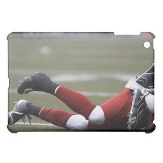 Two American football players lying on field, iPad Mini Covers